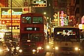 Neon signs and cars at Nathan Road at night, Hong Kong, China, Asia