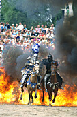 Knights riding trough fire, Kaltenberger Ritterspiele, Bavaria, Germany