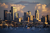Sailing boats on Lake Union in front of high rise buildings in the light of the evening sun, Seattle, Washington, USA, America