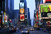 High rise buildings with neon signs and cars on the Times Square, Manhattan, New York, USA, America