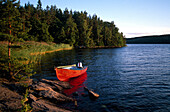 A boat lying at the shore in the evening sun, Vastergotland, Sweden
