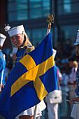 Blond girl with swedish ensign, Goeteborg, Sweden, Europe