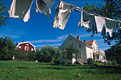 Clothesline and swedish summer residence in the sunlight, Sweden, Europe
