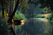 Lonesome rowing boat on river in Spreewald, Brandenburg, Germany
