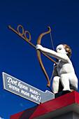 Cupid as signpost, Oktoberfest, Munich