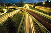 Luminous tracks, blurred motion of automobile headlights, city highway M-30, Madrid, Spain