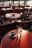 Table with a cup of espresso and a glass of water in a bistro, Karl Johaentges, Paris, France