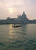 Gondola in front of Santa Maria della Salute in Venice, Italy