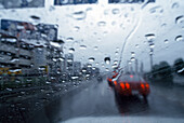 View through the windscreen of a car in the rain