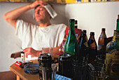 Young man having hangover after drinking alcohol