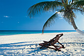Deck chairs on Seven Mile Beach, Grand Cayman, Cayman Islands, Caribbean