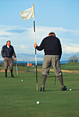 Two men playing golf, St. Andrews, Scotland, Great Britain, Europe
