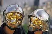 Two firemen wearing futuristic helmets, Paris, France
