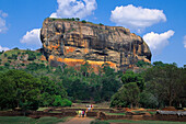People in front of rock of Sigiriya, Sigiriya, Sri Lanka, Asia