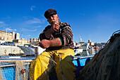 Giuseppe Roselli, 52, fisherman since 40 years, repairing nets, Agrigento, Sicily, Italy, Europe