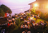 Guests enjoying an evening meal in the garden of Ayuveda Hotel Paragon, Galle, Sri Lanka