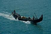 People on a long boat, Kerala India