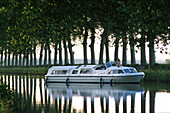 Young woman on a houseboat, Canal du Midi, France, Europe