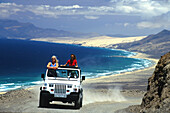People in a jeep above the coast, Fuerteventura, Canary Islands, Spain, Europe