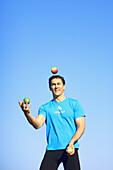 Man juggeling apples, people juggeling
