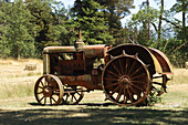 Old harvestmachine in newzealand, landscape automobile