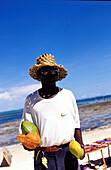 Black men selling coconuts, people vendor on beach