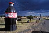 Big bottle as advertising, landscape on street