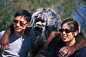 Aborigine posing with two Japanese tourists, Katoomba, Echo Point, New South Wales, Australia