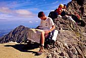 Hiker with map at the Zawrat saddle, High Tatras, Poland