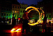 Performance with fire, Old Market Square, Warsaw, Poland