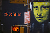 Traffic light showing Don't Walk, Mona Lisa in the background, Manhattan, New York City, USA
