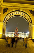 Illuminated gate and christmas tree at night, Palace Square, St. Petersburg, Russia, Europe