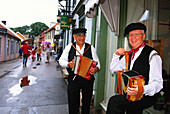 Two street musicians in the historic part of Sigtuna, Sigtuna, Sweden