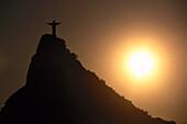 Backlit statue of Jesus Christ on Corcovado mountain, Rio de Janeiro, Brazil, South America, America