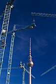 Construction cranes, Television Tower East Berlin, Germany