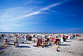 Vacationers relaxing at beach, St. Peter Ording, Schleswig-Holstein, Germany