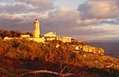 Lighthouse and coastline in the light of the evening sun, Cabo da Roca, Lisbon, Portugal