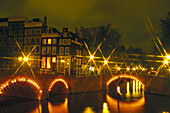 Lighted night canals, Amsterdam Netherlands