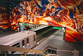 Extensive painting on a wall at a subway station, Brussels, Belgium
