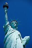 The Statue of Liberty under blue sky, Liberty Island, New York USA, America