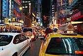 Cars and illuminated advertising at night, 42nd Street & Times Square, Manhattan, New York, USA, America