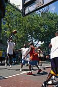 Young men playing basket ball, 6th Avenue, Greenwich Village, Manhattan, New York, USA, America