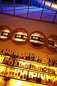 Bottles on shelves at Bar 89, Mercer Street, SoHo, Manhattan, New York USA, America