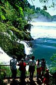 Tourists visiting Rhine Falls, Schaffhausen, Switzerland