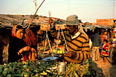 People at the market at a shanty town, New Delhi, India, Asia