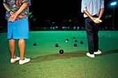 Two people playing lawn bowls, Suva, Fiji Island, Polynesia