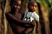 Local children, Local girl carrying smaller child, Damfa Kunda, Gambia, Africa