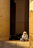 Man sitting in front of the Omayyaden Mosque, Aleppo, Syria