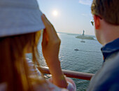 Passengers looking to Statue of Liberty, Queen Mary, New York City, USA