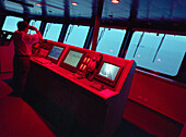 Screens and radars on the command bridge of the Queen Mary 2, Cruise Ship